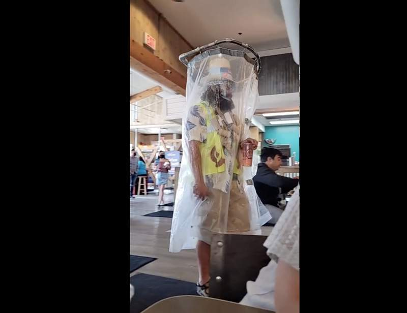 San Antonio man spotted wearing shower curtain contraption instead of mask. (Courtesy of MichaelG4)