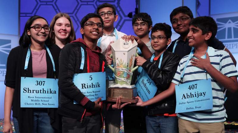Co-champions (L-R) Shruthika Padhy (307), Erin Howard (93), Rishik Gandhasri (5), Christopher Serrao (427), Saketh Sundar (132), Sohum Sukhatankar (354), Rohan Raja (462), and Abhijay Kodali (407), hold the trophy for photographers after 20 rounds of competition and won the championship of the Scripps National Spelling Bee onMay 31, 2019, in National Harbor, Maryland.