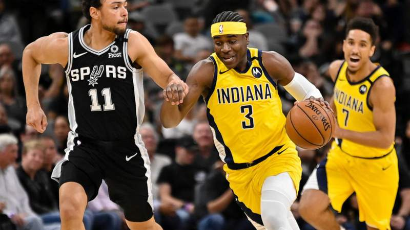 Indiana Pacers' Aaron Holiday (3) drives against San Antonio Spurs' Bryn Forbes during the first half of an NBA basketball game, Monday, March 2, 2020, in San Antonio.