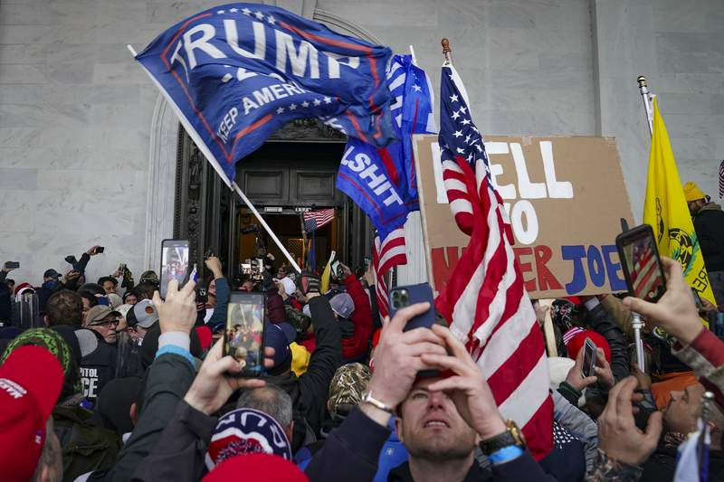 FILE - In this Jan. 6, 2021, file photo, Trump supporters gather outside the Capitol in Washington. (AP Photo/John Minchillo, File)
