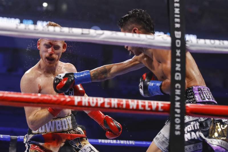 Mario Barrios delivers a strong right against Ryan Karl on October 31, 2020 in the Alamodome. Photo courtesy of Esther Lin and Showtime.