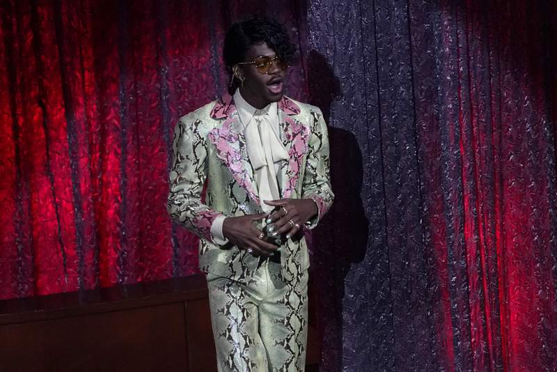 """Lil Nas X accepts the award for top hot 100 song for """"Old Town Road""""at the Billboard Music Awards on Wednesday, Oct. 14, 2020, at the Dolby Theatre in Los Angeles. (AP Photo/Chris Pizzello)"""