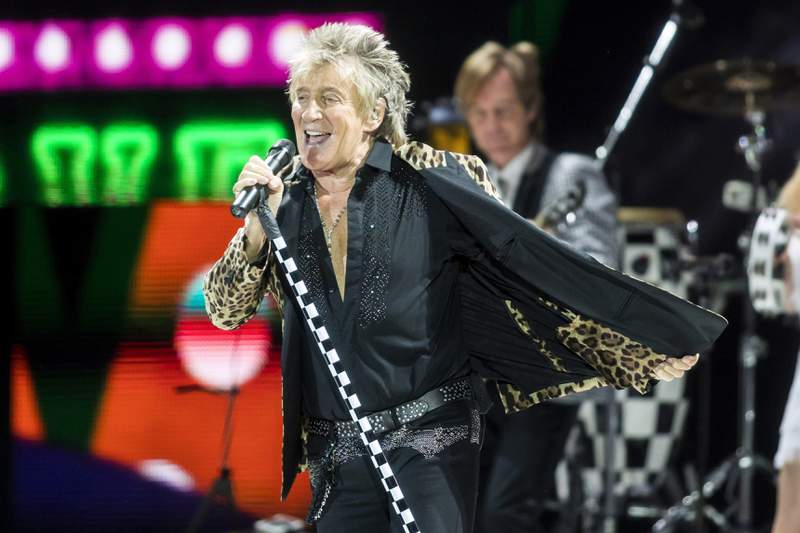 FILE - In this Jan. 29, 2018, file photo, British rock singer Rod Stewart performs during his concert in Papp Laszlo Sports Arena in Budapest, Hungary. Rock star Rod Stewart and his son Sean are facing simple battery charges after an altercation with a security guard at The Breakers hotel in Palm Beach, Fla., on New Year's Eve. (Balazs Mohai/MTI via AP, File)