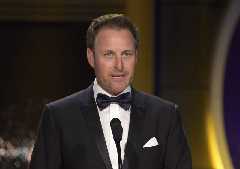 FILE - In this April 29, 2018, file photo, Chris Harrison presents the award for outstanding entertainment talk show host at the Daytime Emmy Awards at the Pasadena Civic Center in Pasadena, Calif. Harrison will not host the upcoming season of The Bachelorette following controversy over racially insensitive comments, and will instead be replaced with two former contestants, ABC Entertainment and Warner Horizon said in a statement Friday, March 12, 2021. (Photo by Richard Shotwell/Invision/AP, File)