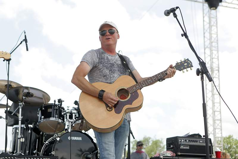 Vocalist/musician Kevin Fowler performs to a sold out crowd during Willie Nelson's 4th of July Picnic at The Backyard on July 4, 2010 in Austin, Texas. (Photo by Gary Miller/FilmMagic)