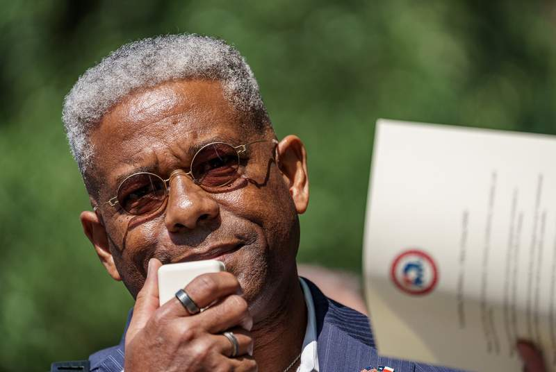 """Texas Republican Party Chairman Allen West speaks to a crowd gathered at the Governors Mansion on Saturday, Oct. 10, 2020 to protest business closures and mask mandates which they call """"King Abbotts Royal Decrees."""""""