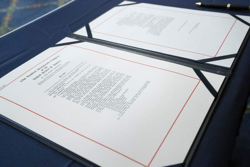 The bill intended to curtail a striking rise in hate crimes against Asian Americans and Pacific Islanders is seen before the signing ceremony, on Capitol Hill in Washington, Wednesday, May 19. 2021. (AP Photo/Jose Luis Magana)