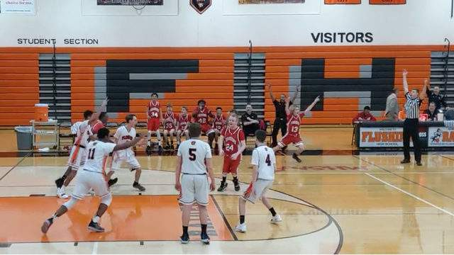 Players from Swartz Creek and Flushing High School's freshman teams cheer after Brian Sefernick (No. 24 in red) makes a 3-point shot during a recent game. Sefernick suffers from cerebral palsy. Photo contributed.
