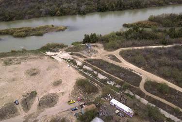 A culvert runs perpendicular to the Rio Grande in Webb County. (Miguel Gutierrez Jr./The Texas Tribune)