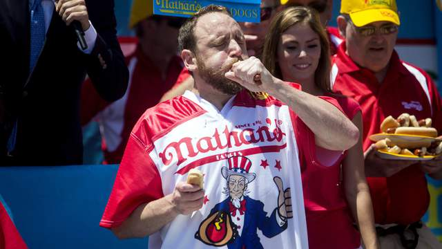 Joey Chestnut chows down on a hot dog at the annual contest held each Fourth of July on Coney Island.