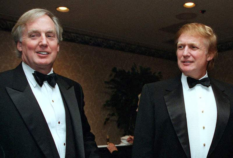 FILE - In this Nov. 3, 1999 file photo, Robert Trump, left, joins then real estate developer and presidential hopeful Donald Trump at an event in New York. Sometimes politics gives way to the personal at the White House. It has seen 18 weddings and at least 10 people are known to have died there, including two presidents and three first ladies. It will serve Friday as a place of mourning for President Donald Trump and his family with a private memorial service for the presidents younger brother, Robert, who passed away at 71.   (AP Photo/Diane Bonadreff, File)