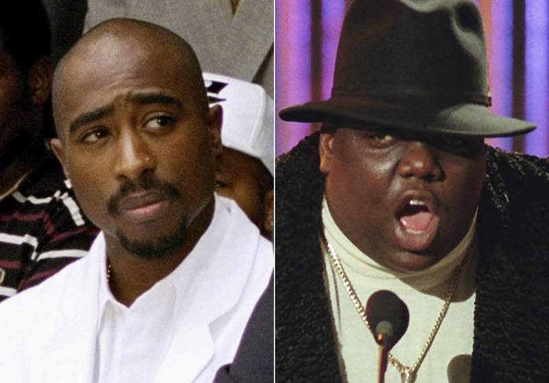 In this combination photo, Tupac Shakur attends a voter registration event in South Central Los Angeles on  Aug. 15, 1996, left, and Notorious B.I.G., winner of best rap artist and rap single of the year, appears at the Billboard Music Awards in New York on Dec. 6, 1995. The late rappers are being united for an auction at Sothebys, the first-ever dedicated hip-hop auction at a major international auction house. Bidders will be able to vie for the crown worn and signed by the Notorious B.I.G. during a 1997 photo shoot held three days before he was killed in Los Angeles. Theyll also get to bid on an archive of 22 autographed love letters written by Shakur at the age of 15 to a high school sweetheart. (AP Photo)