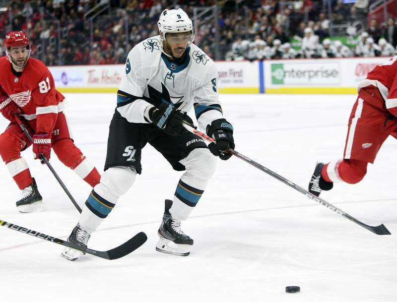 File - In this Dec. 31, 2019, file photo, San Jose Sharks left wing Evander Kane (9) looks to pass the puck while being pursued by Detroit Red Wings center Frans Nielsen (81), of Denmark, during the first period of an NHL hockey game in Detroit. Seven current or former black NHL players have formed the Hockey Diversity Alliance to fight racism and intolerance in the sport. Akim Aliu and San Jose's Kane will lead the group, which also includes Trevor Daley, Matt Dumba, Wayne Simmonds, Chris Stewart and recently retired Joel Ward. (AP Photo/Duane Burleson, File)