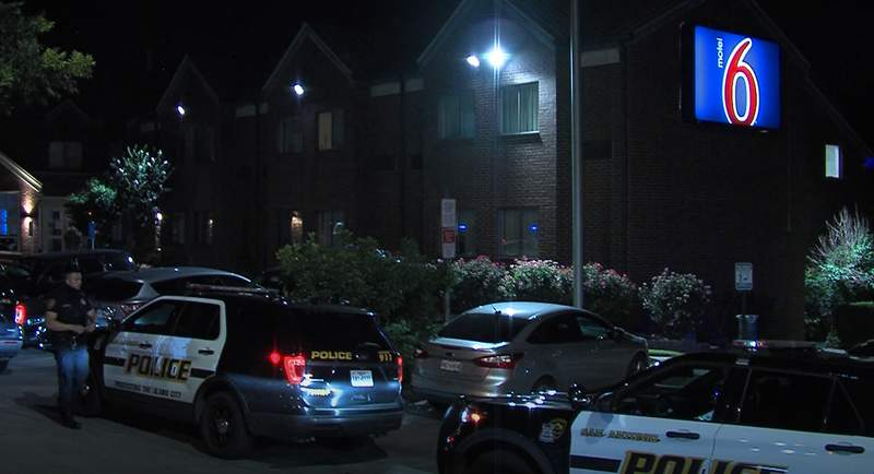 A woman was fatally shot in front of her two children in a motel room overnight, and the man responsible is now in custody, according to San Antonio police.