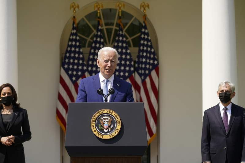President Joe Biden, accompanied by Vice President Kamala Harris, and Attorney General Merrick Garland, speaks about gun violence prevention in the Rose Garden at the White House, Thursday, April 8, 2021, in Washington. (AP Photo/Andrew Harnik)