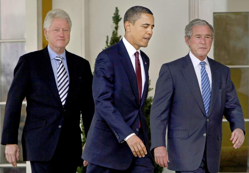 FILE - In this Jan. 16, 2010, file photo President Barack Obama, center, walks out of the Oval Office of the White House with former Presidents Bill Clinton, left, and George W. Bush, right, to deliver remarks in the Rose Garden at the White House in Washington.  Three former presidents say they'd be willing to take a coronavirus vaccine publicly, once one becomes available, to encourage all Americans to get inoculated against a disease that has already killed more than 273,000 people nationwide. (AP Photo/Pablo Martinez Monsivais, File)
