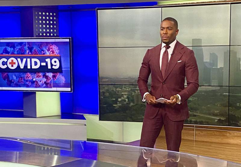 Chauncy Glover, news anchor at KTRK, appears in the studo in Houston on  March 16, 2020. Calling a hospital to see if a bed was available for a COVID patient isn't part of Glover's job description. Neither is guiding a viewer online to find a place to be vaccinated. He's done both, and isn't alone. Listeners and readers across the country are reaching out directly to journalists for help during the coronavirus pandemic, and many are responding. (Chauncy Glover via AP)