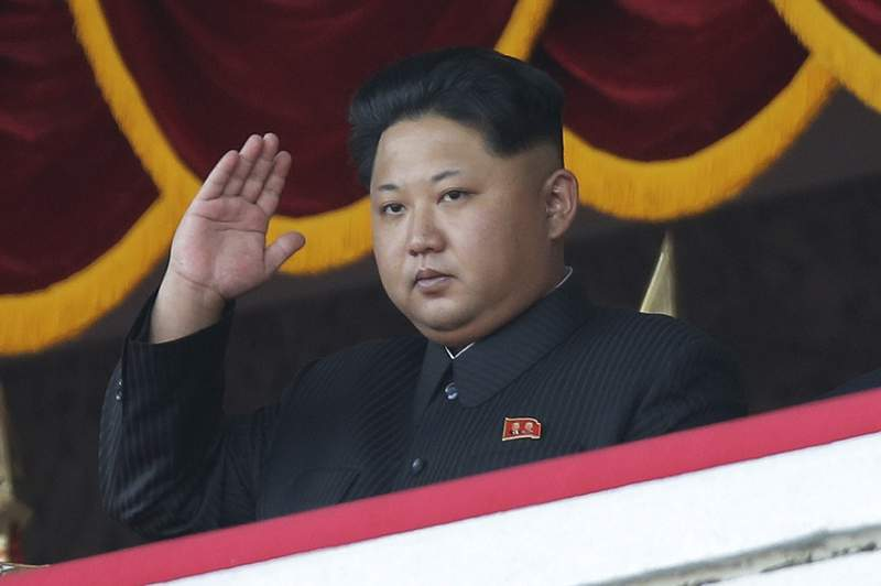 FILE - In this Oct. 25, 2015, file photo, North Korean leader Kim Jong Un gestures as he watches a military parade during celebrations to mark the 70th anniversary of North Korea's Workers' Party in Pyongyang, North Korea. Kim Jong Un has ordered at least two people executed, banned fishing at sea and locked down the capital, Pyongyang, as part of frantic efforts to guard against the coronavirus and its economic damage, South Korea's spy agency told lawmakers Friday. (AP Photo/Wong Maye-E, File)