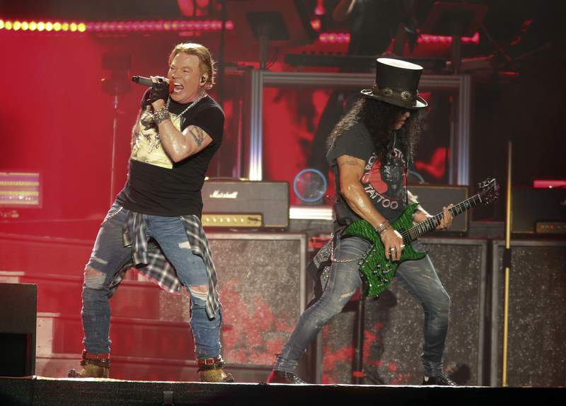 FILE - Guns N' Roses' Axl Rose, left, and Slash perform on the first weekend of the Austin City Limits Music Festival on Oct. 4, 2019, in Austin, Texas.  The hard rock band has booked two dates at the Hard Rock casino in Atlantic City, N.J., Sept. 11 and 12.  (Photo by Jack Plunkett/Invision/AP)