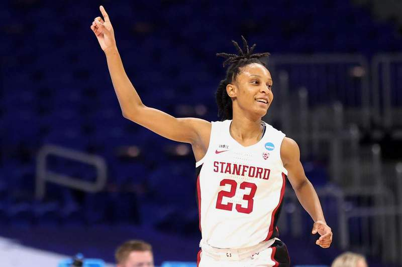 Kiana Williams #23 of the Stanford Cardinal reacts to a three point basket against the Utah Valley Wolverines during the first half of the first round game of the 2021 NCAA Women's Basketball Tournament at the Alamodome on March 21, 2021 in San Antonio, Texas.