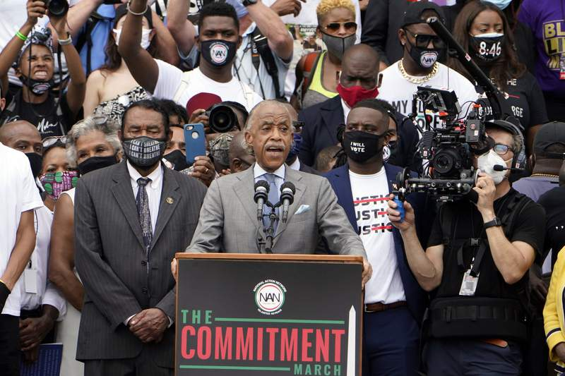 Rev. Al Sharpton, founder and president of National Action Network, speaks at the March on Washington, Friday Aug. 28, 2020, at the Lincoln Memorial in Washington. Ask left is Rep. Al Green, D-Texas. (AP Photo/Jacquelyn Martin, Pool)