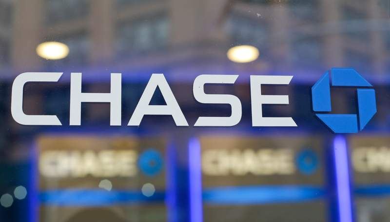 FILE - This Sept. 13, 2014, file photo, shows the Chase bank logo in New York. JPMorgan Chase says profits improved marginally in the third quarter, a notable change after the nations largest bank had to set aside billions in the last two quarters to cover losses from the coronavirus pandemic. The New York-based bank said it earned a profit of $9.44 billion, or $2.92 a share, in the July to September period.  (AP Photo/Frank Franklin II, File)