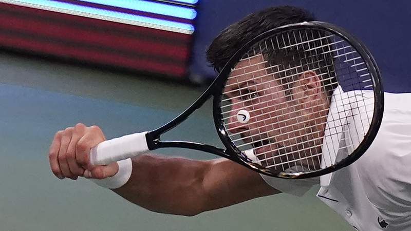 Novak Djokovic, of Serbia, returns a serve to Roberto Bautista Agut, of Spain, during the semifinals at the Western & Southern Open tennis tournament Friday, Aug. 28, 2020, in New York. (AP Photo/Frank Franklin II)