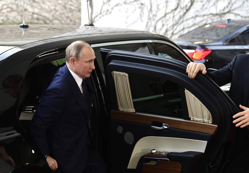 FILE - In this Jan. 19, 2020, file photo Russian President Vladimir Putin arrives for a conference on Libya at the chancellery in Berlin, Germany. A whistleblowers allegation that he was pressured to suppress intelligence about Russian election interference is the latest in a series of similar accounts involving former Trump administration officials, raising concerns the White House risks undercutting efforts to stop such intrusions if it plays down the seriousness of the problem. (AP Photo/Jens Meyer, File)