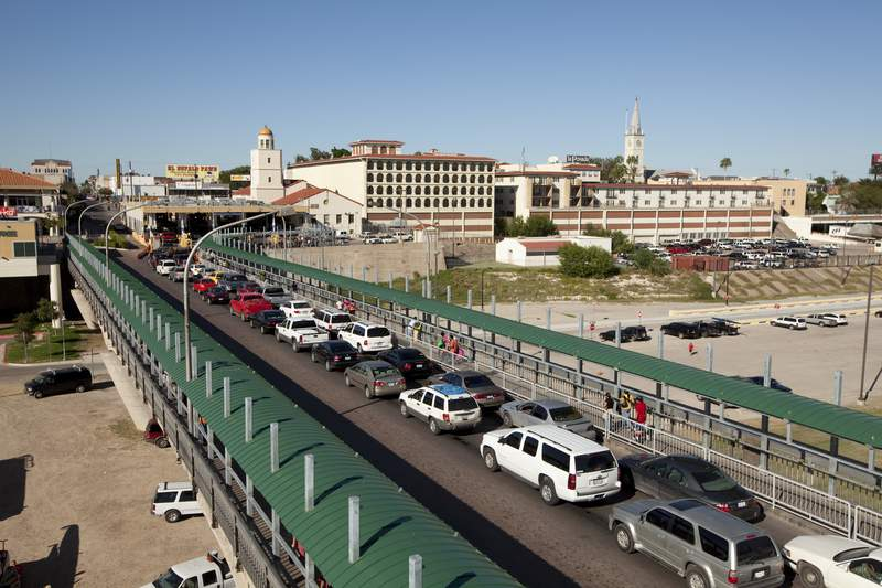 International Bridge No. 1 spans the Rio Grande River looking toward Laredo coming from the larger city of Nuevo Laredo, Tamaulipas, Mexico as lines of automobiles stream toward the United States. (Photo by Robert Daemmrich Photography Inc/Corbis via Getty Images)