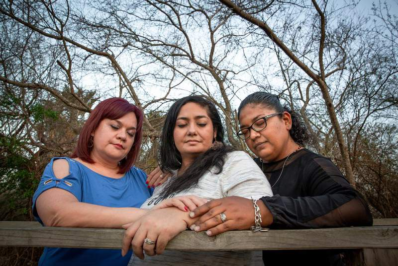 From left, Delia Ramos, Betty Fuentes and Ana Flores Arguelles embrace in prayer in Harlingen on March 11, 2021. The trio lost their husbands to COVID-19.                    (Credit: Jason Garza for The Texas Tribune)