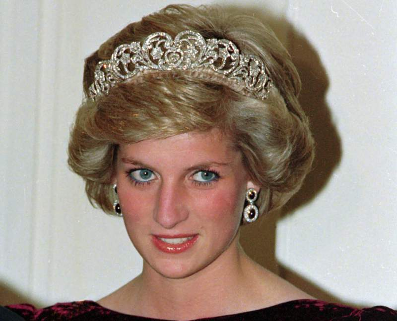 FILE - In this file photo dated Nov. 7, 1985, Britain's Princess Diana wears the Spencer tiara as she and Prince Charles attend state dinner at Government House in Adelaide, Austraila.  The BBCs board of directors has announced Wednesday Nov. 18, 2020, the appointment of a retired senior judge to lead an independent investigation into the circumstances around a controversial 1995 TV interview with Princess Diana.  (AP Photo/Jim Bourdier, FILE)