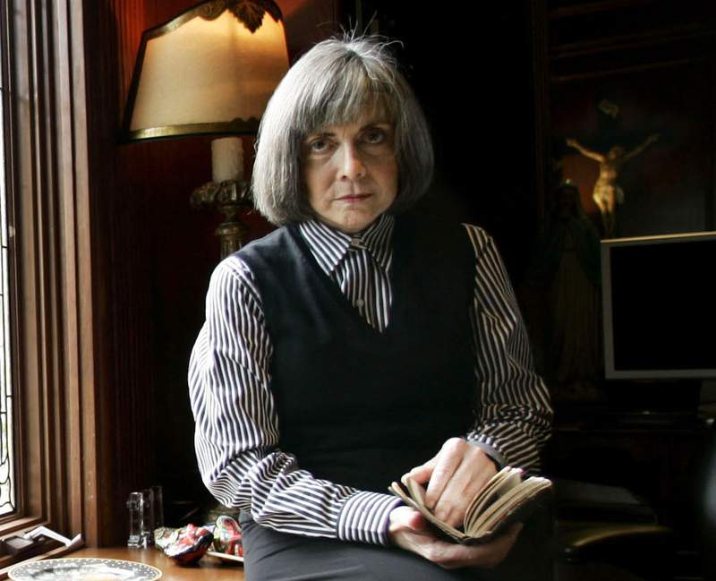 FILE - Author Anne Rice poses for a photo at her home Oct. 26, 2005, in San Diego. Rices Interview with the Vampire is rising again on screen, this time for TV. The bestselling novel, which was adapted for the 1994 Brad Pitt-Tom Cruise film, will be the basis for a new AMC and AMC+ series set for 2022. (AP Photo/Lenny Ignelzi, File)