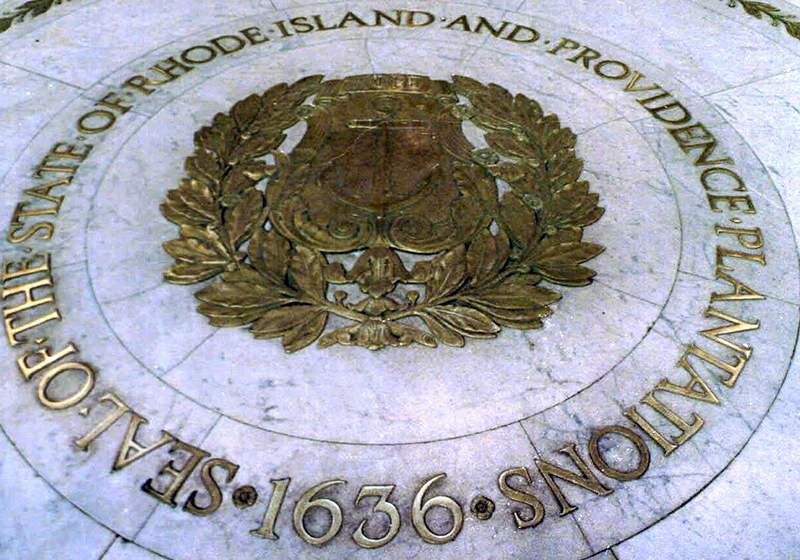 "FILE - This Jan. 21, 2000 file photo shows the seal of the State of Rhode Island and Providence Plantations on the floor of the Statehouse rotunda in Providence, R.I. On Thursday, July 16, 2020, state lawmakers approved placing a question on the November ballot to allow voters the option to remove ""and Providence Plantations"" from the state's official name. (AP Photo/Susan E. Bouchard, File)"