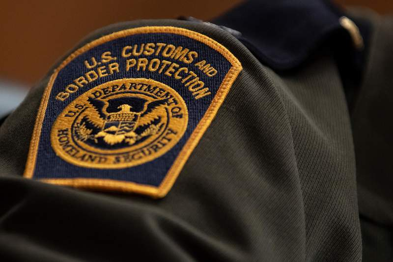 A U.S. Customs and Border Protection patch on an agent's uniform (Photo by Alex Edelman/Getty Images)