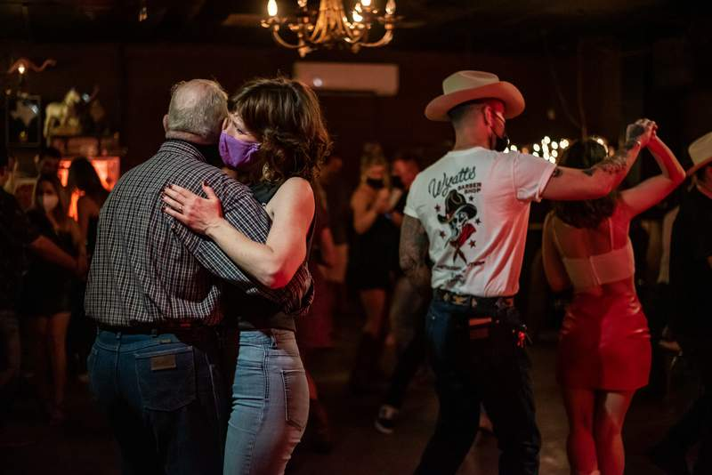 People dance inside White Horse in East Austin on March 12, 2021. After Gov. Greg Abbott announced that all businesses are allowed to open without any occupancy limits and lifted restrictions on masks, Mayor Steve Adler said residents would still be required to wear masks.