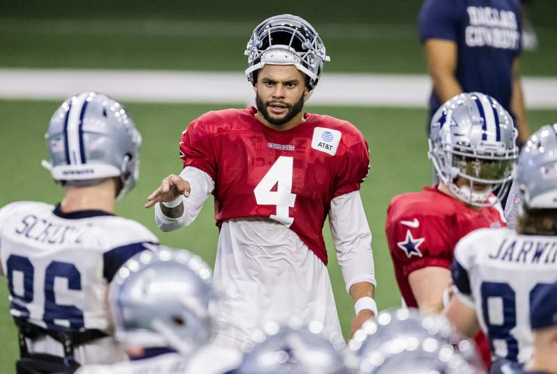 Dallas Cowboys quarterback Dak Prescott (4) gives instructions to his teammates during an NFL football training camp practice at The Star, Friday, Aug. 28, 2020, in Frisco, Texas. (AP Photo/Brandon Wade)