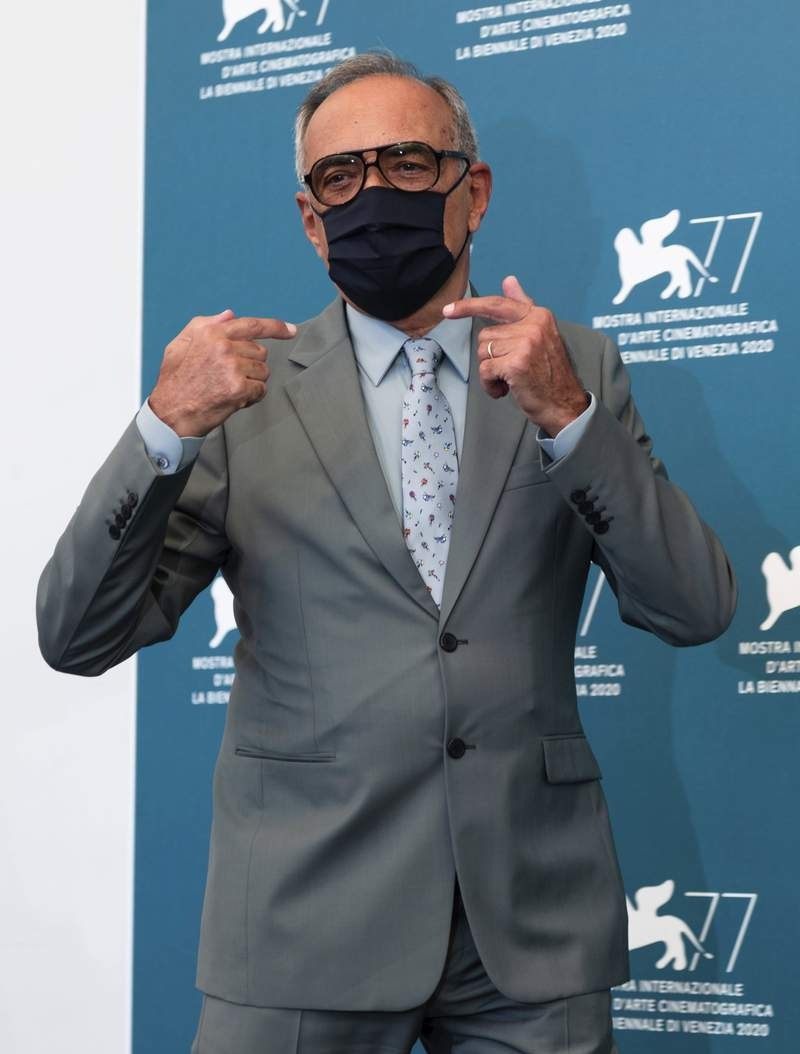 Alberto Barbera director of the Venice Film Festival poses during a photo call of the 77th edition of the Venice Film Festival at the Venice Lido, Italy, Tuesday, Feb. 18, 2020. The Venice Film Festival will go from Sept. 2 through Sept. 12. Italy was among the countries hardest hit by the coronavirus pandemic, and the festival will serve as a celebration of its re-opening and a sign that the film world, largely on pause since March, is coming back as well. (AP Photo/Domenico Stinellis)