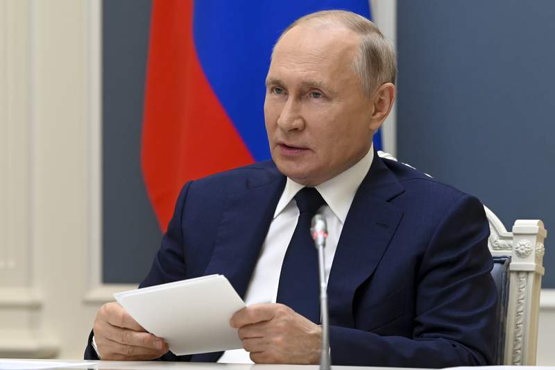 Russian President Vladimir Putin takes part in a video call with Belarusian President Alexander Lukashenko and Russian and Belarusian officials in Moscow, Russia, Thursday, July 1, 2021. (Alexei Nikolsky, Sputnik, Kremlin Pool Photo via AP)