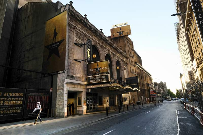 """FILE - In this May 13, 2020, file photo, """"Hamilton: An American Musical"""" at the Richard Rodgers Theatre is closed during Covid-19 lockdown, in New York. The U.S. labor union that represents more than 51,000 theater actors and stage managers is blasting a proposal that would raise eligibility requirements for members to receive health care. The Equity-League Pension Health Fund on Thursday, Oct. 1, 2020, proposed hiking the number of weeks of employment needed to qualify for six months of health care coverage from 11 weeks to 16 weeks. The proposal would start on Jan. 1, 2021. (Photo by Evan Agostini/Invision/AP, File)"""