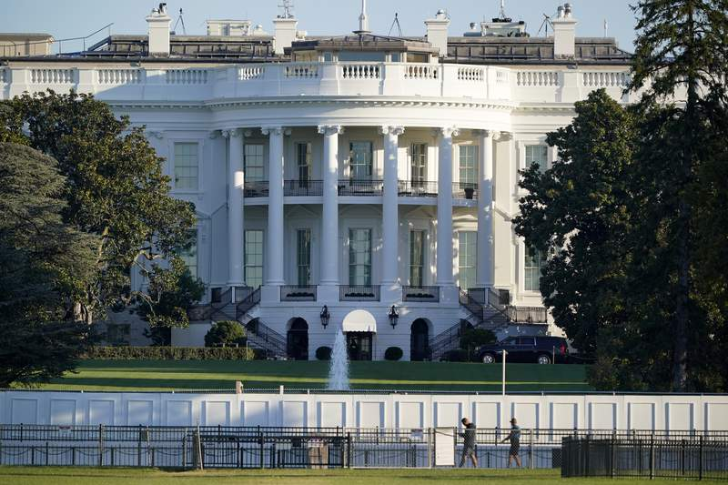 The White House is seen in Washington, early Saturday, Oct. 3, 2020, the morning after President Donald Trump was taken to a military hospital after being stricken by COVID-19. (AP Photo/J. Scott Applewhite)