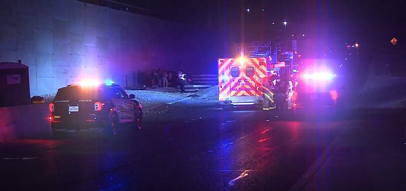 A man is hospitalized following a two-vehicle crash on the Northwest Side, and San Antonio police are still searching for the driver who caused the wreck.