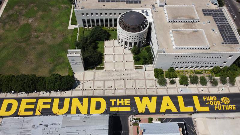 Laredo residents paint 'Defund the Wall' on street outside federal courthouse