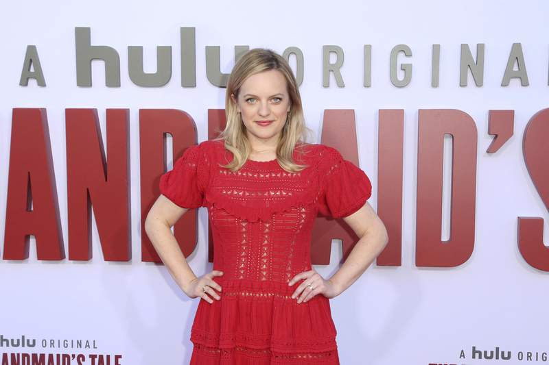 """FILE - In this Tuesday, Aug. 6, 2019, file photo, Elisabeth Moss attends the """"The Handmaid's Tale"""" season three finale red carpet at the Regency Village Theatre, in Los Angeles. The drama series fourth season begins April 28, 2021, and will include 10 episodes. (Photo by Willy Sanjuan/Invision/AP, File)"""