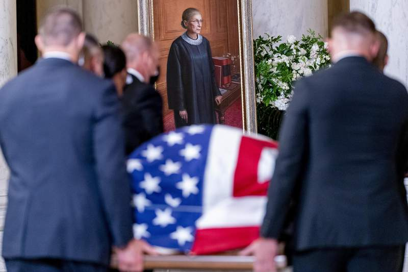 The flag-draped casket of Justice Ruth Bader Ginsburg, carried by Supreme Court police officers, arrives in the Great Hall at the Supreme Court in Washington, Wednesday, Sept. 23, 2020. Ginsburg, 87, died of cancer on Sept. 18. (AP Photo/Andrew Harnik, Pool)