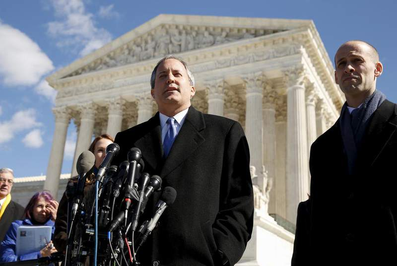 Texas Attorney General Ken Paxton addresses reporters on the steps of the U.S. Supreme Court in 2016. The high court declined to hear a lawsuit Paxton's office filed against California over its ban on state-sponsored travel here. (Credit: REUTERS/Kevin Lamarque)