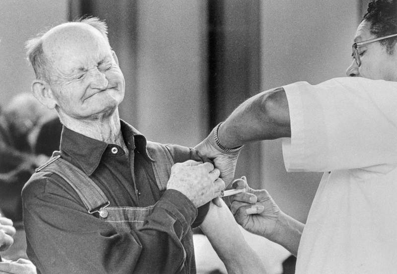 In this 1976 photo, Temple Sharkey winces as he gets a swine flu shot at a clinic as public demand for a vaccine soared after a case of the disease was reported in Missouri. Health officials say they will probably never be sure the man had swine flu because of the lack of a throat swab.