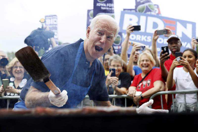 "FILE - In this Sept. 21, 2019, file photo when former Vice President Joe Biden was running for president, Biden works the grill during the Polk County Democrats Steak Fry in Des Moines, Iowa. President Joe Biden spent only a weekend as the ""Hamburglar"" in the conservative media world, but the incident illustrated the speed at which a false and damaging story can spread. The Daily Mail wrote about things that could potentially be in a Biden climate change plan, and cited an academic study that mentioned reductions in greenhouse gases that could be achieved with limits on beef consumption. (AP Photo/Charlie Neibergall)"