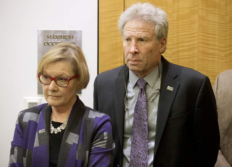 FILE - In this Jan. 29, 2016 file photo, Andy Parker and his wife, Barbara, listen as Virginia Gov. Terry McAulliffe announces a compromise on a set of gun bills at the Capitol in Richmond, Va. The family of a slain journalist is asking the Federal Trade Commission, Tuesday, Oct. 12, 2021,  to take action against Facebook for failing to remove online footage of her shooting death. Andy Parker says the company is violating its own terms of service in hosting videos on Facebook and its sibling service Instagram that glorify violence. His daughter, TV news reporter Alison Parker, and cameraman Adam Ward were killed by a former co-worker while reporting for Roanoke, Virginias WDBJ-TV in August 2015. (AP Photo/Steve Helber)