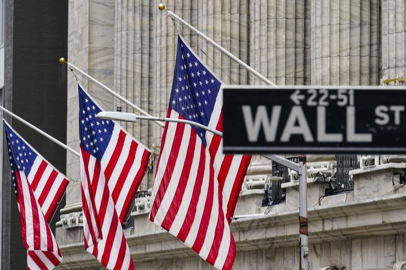 FILE - American flags hang outside of the New York Stock Exchange, in this Tuesday, Feb. 16, 2021, file photo. The White House believes it has an ally in the bond markets to make the case that inflation isn't an economic threat. (AP Photo/Frank Franklin II, File)