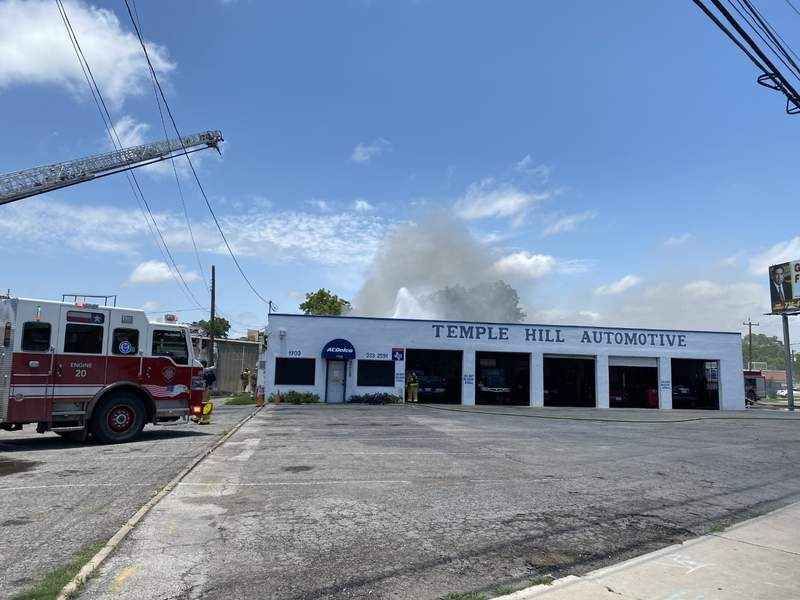 Multiple cars went up in flames after a fire ravaged through a Southeast Side auto repair shop Sunday, according to the San Antonio Fire Department.